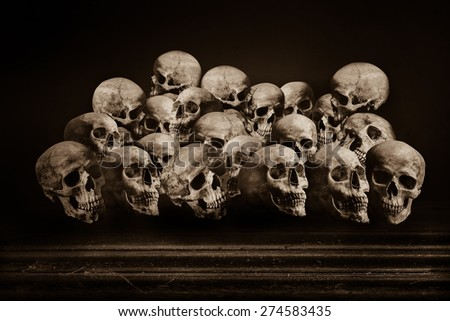 Human skulls on grunge wooden table - stock photo