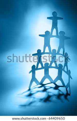 Human team pyramid. Blue tone - stock photo