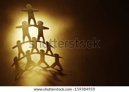 Human team pyramid. Copy space - stock photo