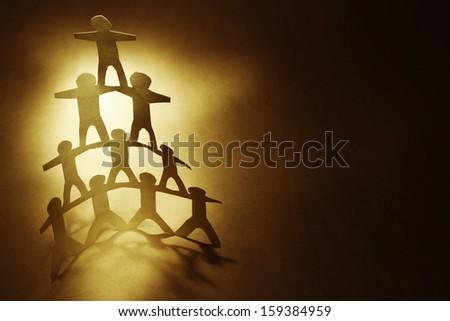 Human team pyramid. Copy space - stock photo