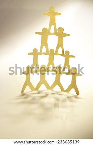 Human team pyramid holding hands - stock photo