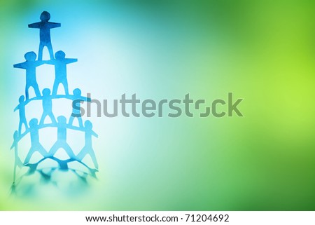 Human team pyramid on color background. Copy space. - stock photo
