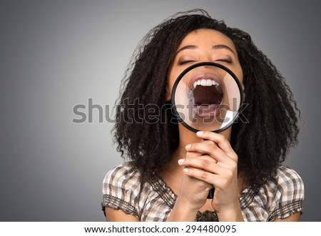 Human Teeth, Smiling, Magnifying Glass. - stock photo