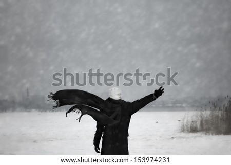 Human with bandaged head under the nuclear snowstorm - stock photo