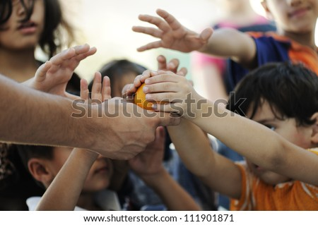 Humanitarian food for poor children in refugee camp - stock photo