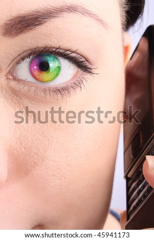 Humanity eye with multicolor lens closeup - stock photo