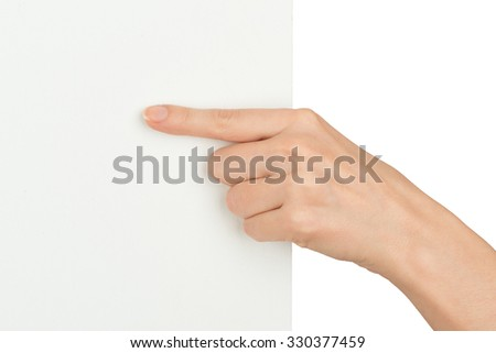 Humans hand with pointer finger holding edge of blank card on isolated white background, close up view