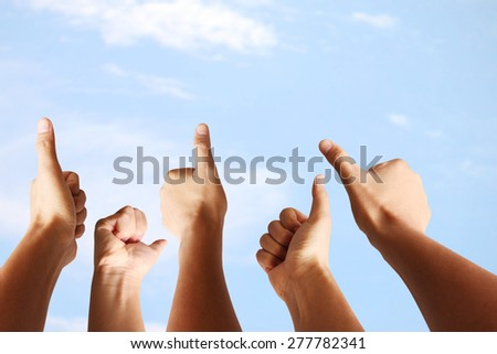 Humans hands, showing thumbs, OK sign