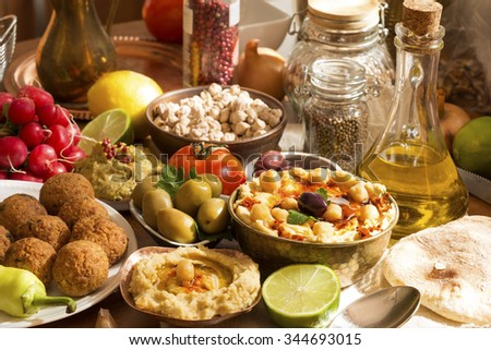 Hummus and falafel meal with ingredients - stock photo