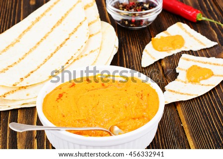 Hummus with Curry, Turmeric, Raw Chickpeas on the Boards Studio Photo