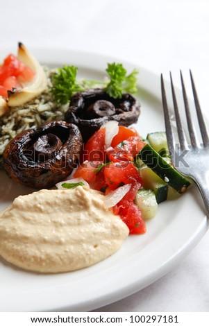 Hummus with persian salad - stock photo