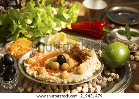 Hummus with the fresh vegetables and chickpeas - stock photo