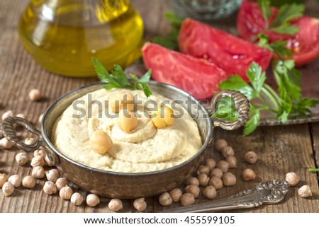 Hummus with tomato and parsley,