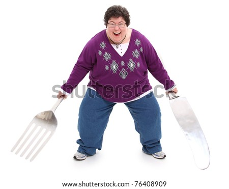 Humor image of excited overweight woman with giant fork and knife over white with clipping path.