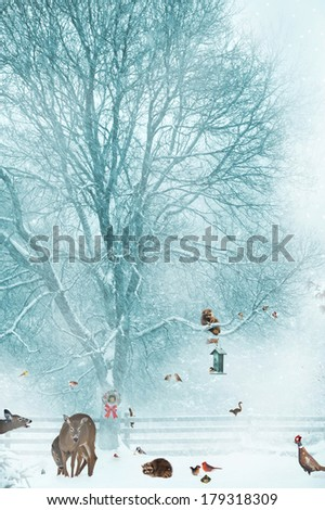 Humorous Christmas card design with birds, and other wildlife gathering around a bird feeder during a snow storm.  - stock photo
