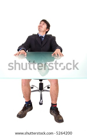 Humorous concept: A businessman, on a suit, sitting on his desk, without pants. - stock photo