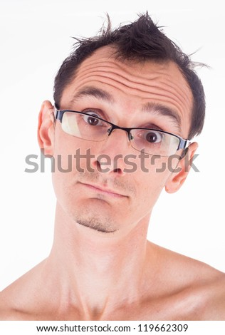 Humorous emotional portrait of grimacing young man - stock photo