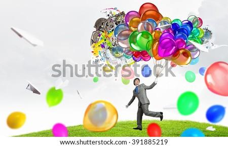 Humorous guy with balloons - stock photo