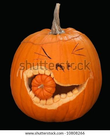 humorous large pumpkin eating smaller pumpkin - stock photo