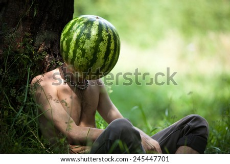 Humorous photo of a boy with a watermelon instead of head