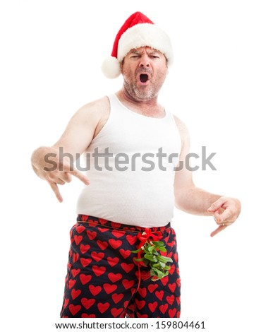 Humorous photo of a guy in boxer shorts with mistletoe over his crotch, asking for oral sex for Christmas.  Isolated on white.   - stock photo