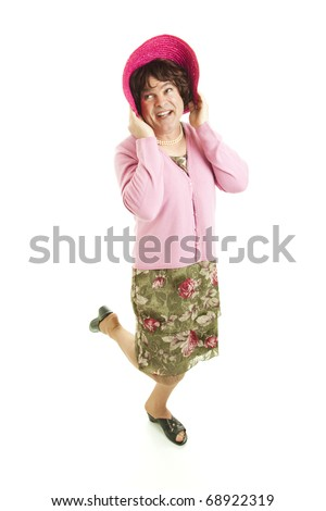 Humorous photo of a man dressed as a woman.  Full body, isolated on white. - stock photo