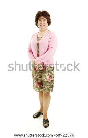 Humorous photo of a middle-aged man dressed as a woman.  Isolated on white. - stock photo