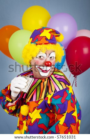 Humorous picture of an alcoholic clown sneaking a drink from his flask.