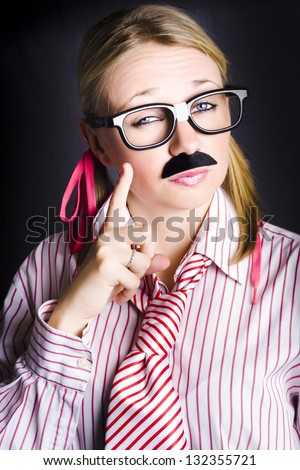 Humorous portrait of a smart senior business executive with false moustache gesturing a one finger solution of genius ideas