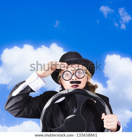 Humorous portrait of an elderly driver holding steering wheel while struggling to see the road, sky background - stock photo