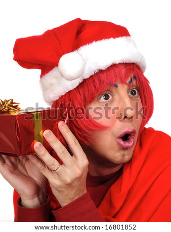 Humorous scene of a young man waiting to know his Christmas surprise