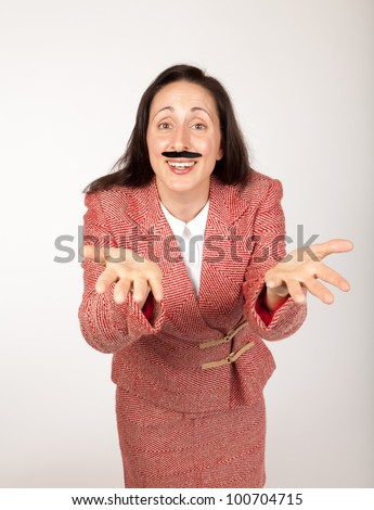 Humorous shot of a silly looking businesswoman with a binder and a fake mustache and outstretched hands