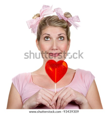 Humorous woman holding a red valentines heart, isolated on a white background