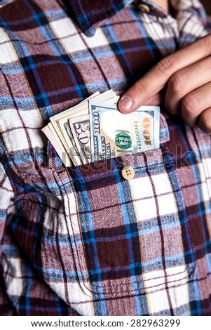 hundred american dollars in the pocket of shirt - stock photo