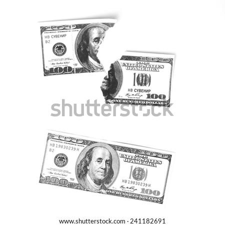 Hundred dollar bill and a broken bill - stock photo