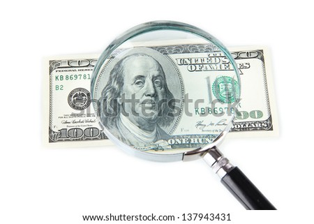 Hundred dollar bill and magnifying glass isolated on white - stock photo