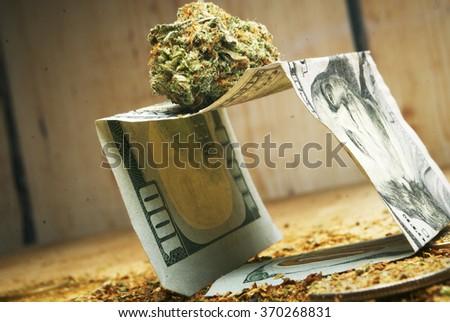 hundred dollar bill and marijuana, marijuana business  - stock photo