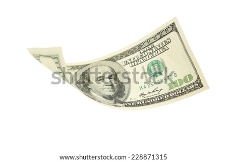 Hundred dollar bill falling on white background - stock photo