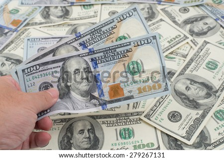 hundred dollar bill on a pile of money      - stock photo