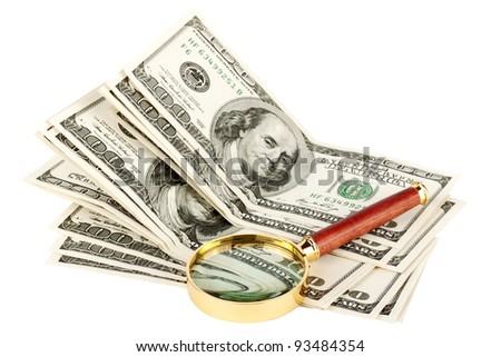 Hundred dollar bill under a magnifying glass  on the white - stock photo