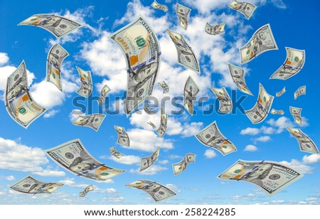 Hundred-dollar bills falling from the sky.