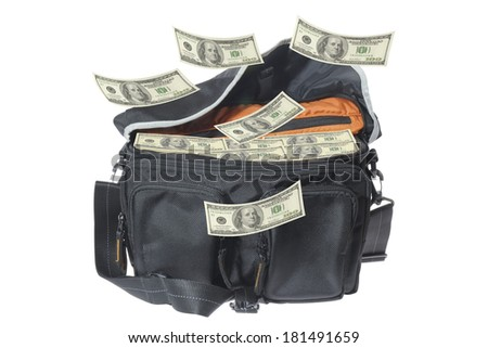 Hundred-dollar bills falling  to the bag. - stock photo