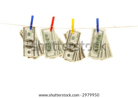 Hundred dollar bills hanging on rope - stock photo