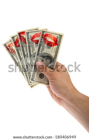 Hundred dollar bills held in hand with lipstick prints on white background  - stock photo