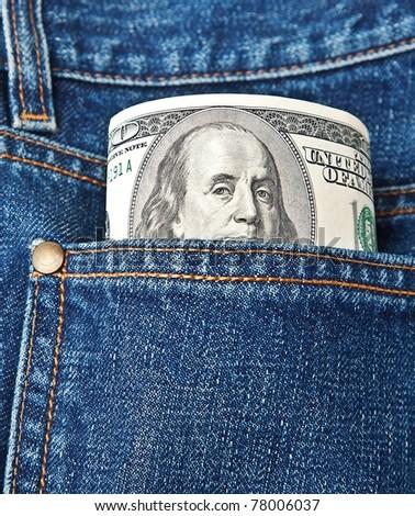 hundred-dollar bills in jeans pocket - stock photo