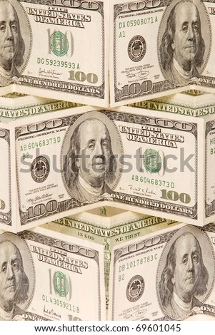 Hundred dollar bills money pile. Focus on center of a photo