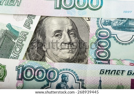 Hundred dollars and Russian banknotes. concept