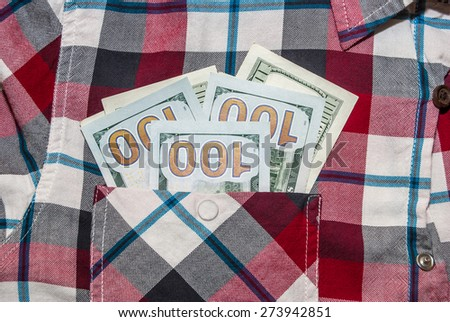 hundred dollars money into the shirt pocket. Cash - stock photo