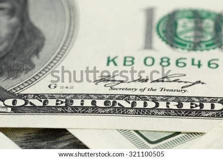 hundred dollars notes background, closeup with shallow focus - stock photo