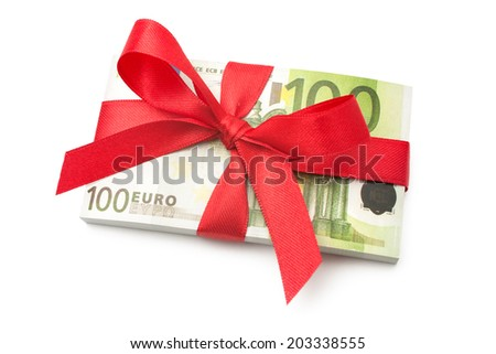 Hundred euro banknotes on a stack with red bow - stock photo